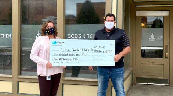 gk molina 600x335 - WZZM13: Molina Healthcare donates $10K to Catholic Charities West Michigan